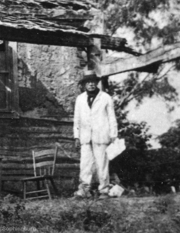 Christian (Karl) Klinger in front of the ruins of the old Sophienburg c.1878.