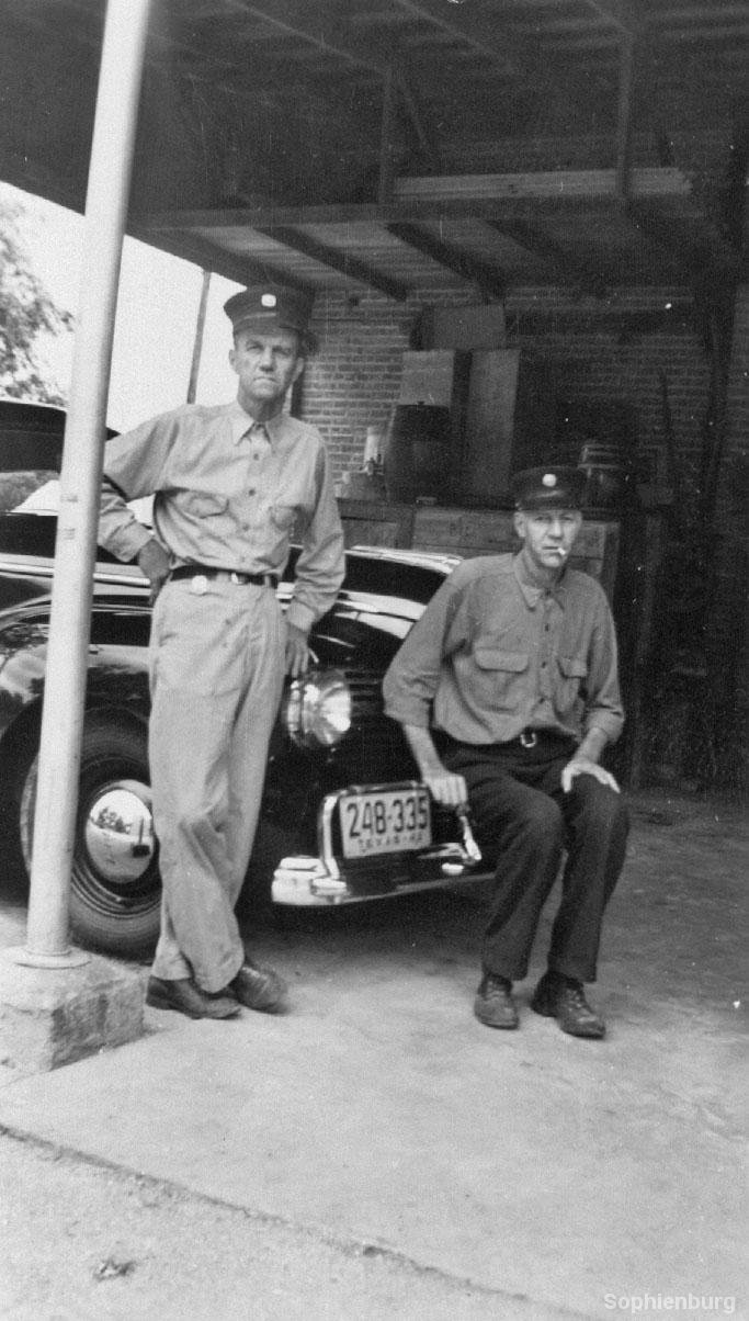 The back of the fire station during shift in 1946, Chili Voigt and unknown fireman.