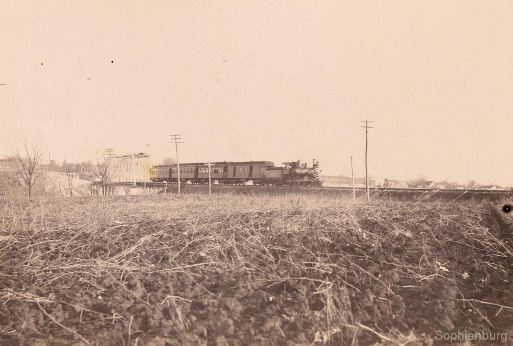 Passenger train crossing bridge, circa 1880. (Sophienburg Archives 1177-2B)